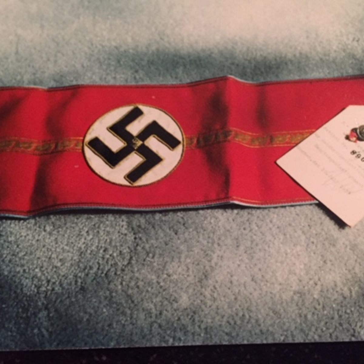 HIGH RANKING NAZI ARMBAND WITH ISSUE AND MANUFACTURERS TAGS.