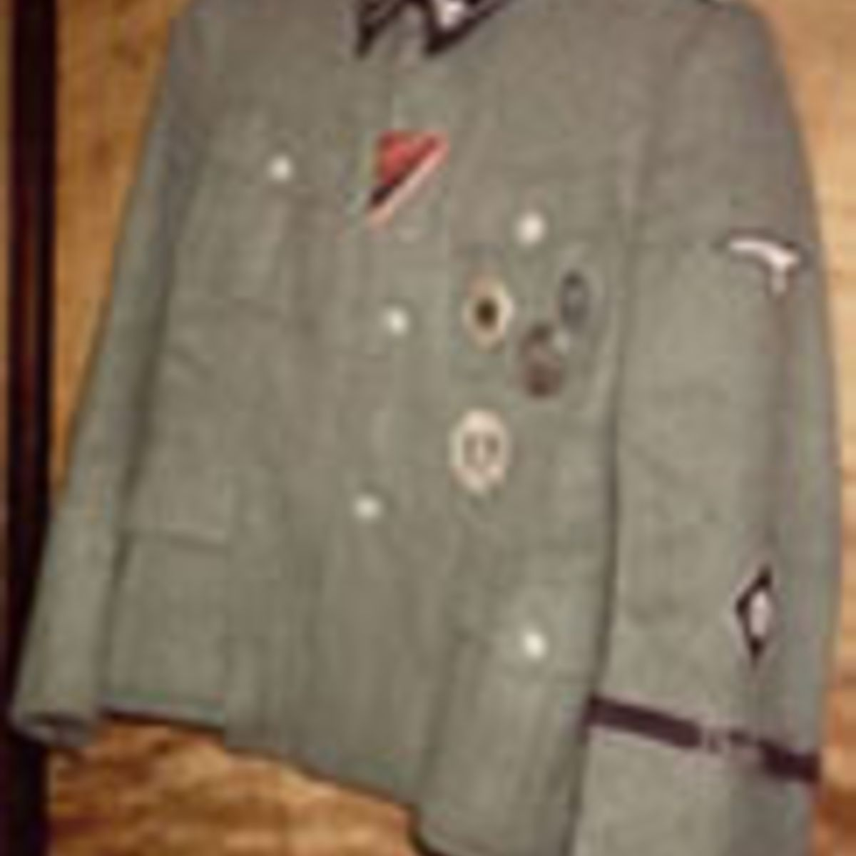 SS TUNIC COMPLETE WITH ORIGINAL AWARDS INCLUDING A GERMANIC PROFICIENCY RUNES SPORTS BADGE AND 'THULE' CUFF TITLE.