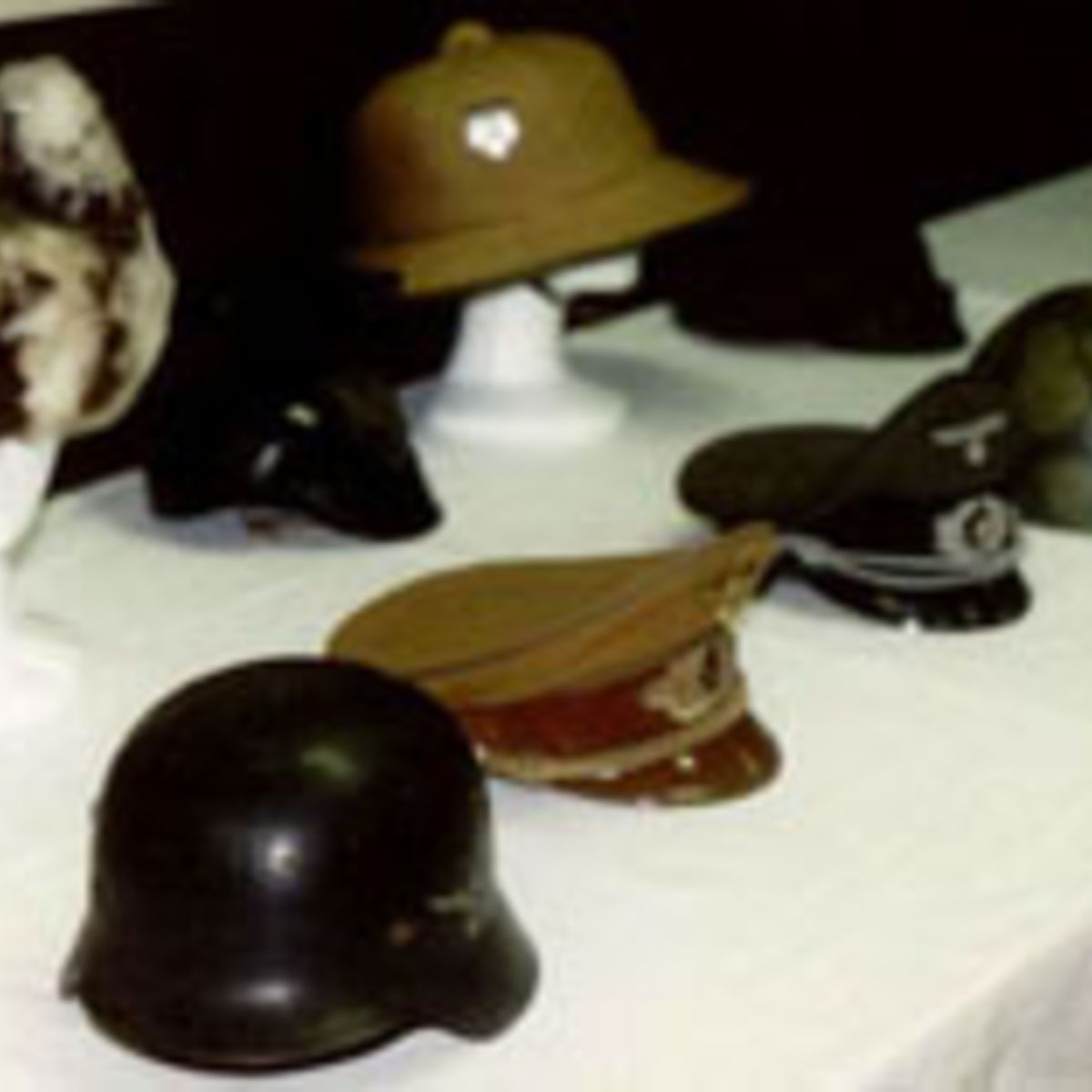 WWII NAZI HELMET AND HEADGEAR COLLECTION.